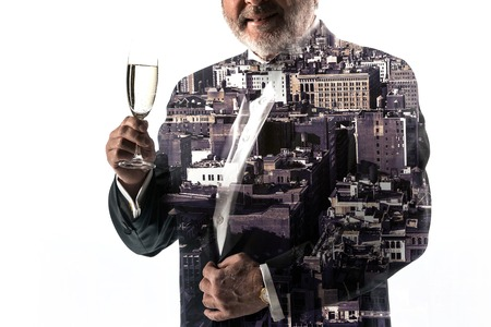 Portrait of bearded businessman. Double exposure city on the background.