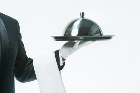 Close up waiter hand with tray and metal cloche lid cover Stock Photo