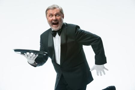 Senior waiter holding tray Reklamní fotografie
