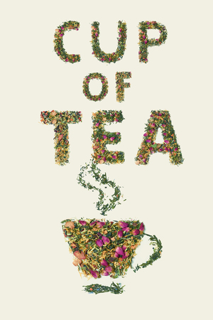 Tea leaf with flowers and fruit word cup of tea on white background, top view