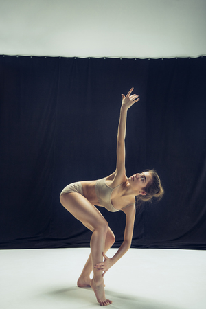 Young teen dancer ion white floor background. Stock Photo