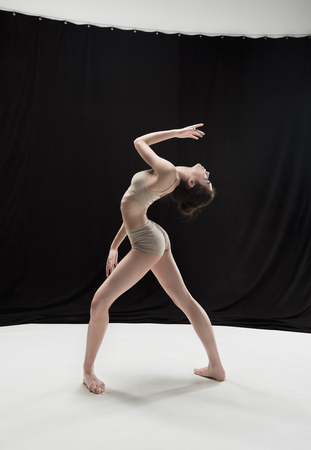 Young teen dancer on white floor background. Stock Photo