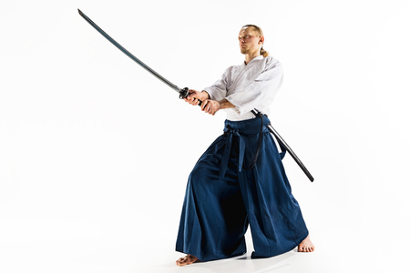 The young man are training Aikido at studio Stock Photo - 94977318