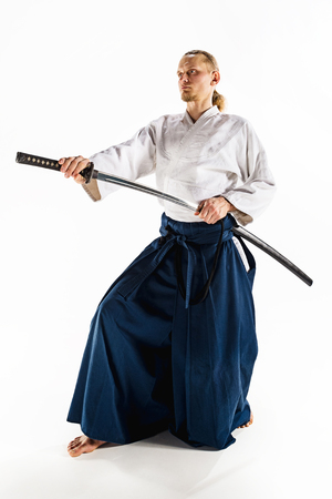 The young man are training Aikido at studio Stock Photo - 94977319