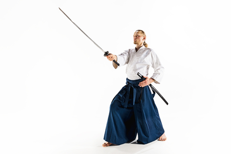 The young man are training Aikido at studio Stock Photo - 94977323