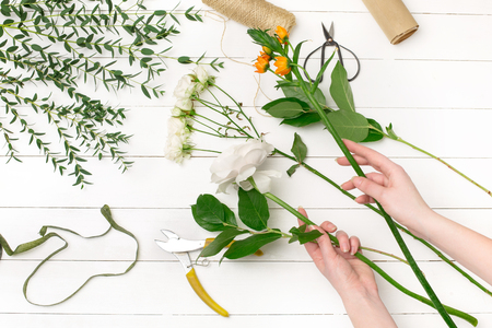 Female florist making beautiful bouquet at flower shop 版權商用圖片