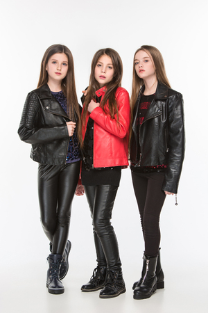 Studio portrait of young attractive caucasian teen girls posing at studio