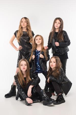 Studio portrait of young attractive caucasian teen girls posing at studio
