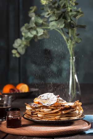 Fresh homemade french crepes made with eggs, milk and flour, filled with marmalade on a vintage plate