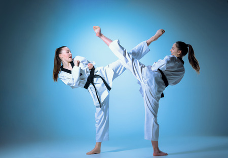 The studio shot of group of kids training karate martial arts 스톡 콘텐츠