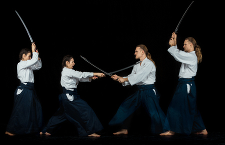 Man and woman fighting at Aikido training in martial arts school Stock Photo - 95513863