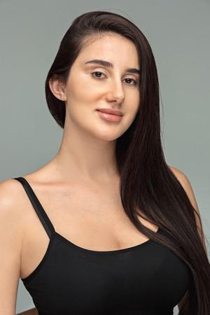 Portrait of beautiful dark-haired girl Stock Photo