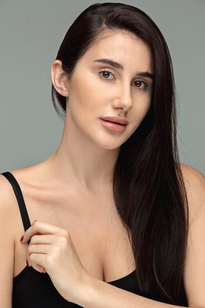 Portrait of beautiful dark-haired girl Standard-Bild