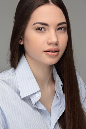 Portrait of beautiful teen dark-haired girl