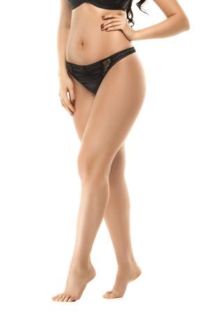 Portrait of beautiful fat woman in lingerie or underwear posing in studio. Stock Photo