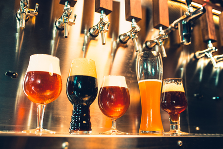 Beer taps in a pub Imagens