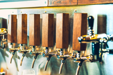 Beer taps in a pub Stock Photo - 96160003