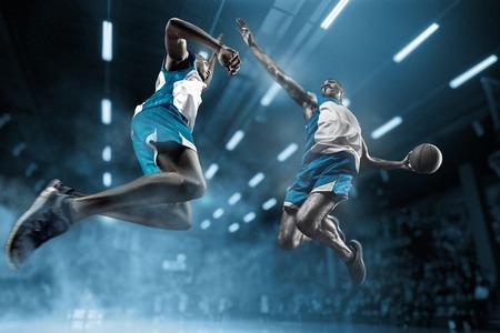 Basketball player on big professional arena during the game. Basketball player making slam dunk. Standard-Bild