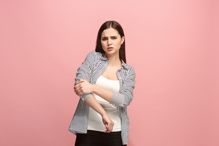The elbow ache. The sad woman with elbow ache or pain on a pink studio background. Stok Fotoğraf