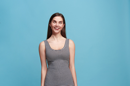The squint eyed woman with weird expression isolated on blue Stock Photo