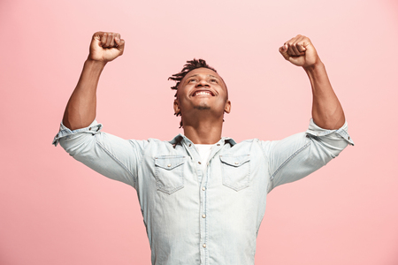 Winning success man happy ecstatic celebrating being a winner. Dynamic energetic image of male model