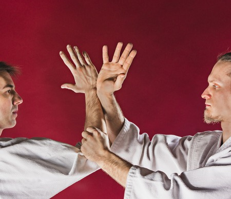 Two men fighting at Aikido training in martial arts school