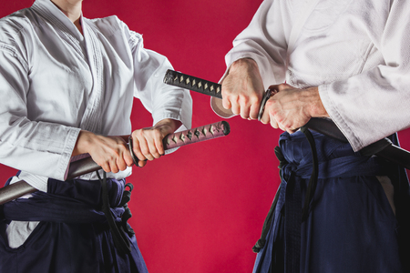 The two men are training Aikido at studio Stock Photo - 96693272