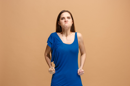 Portrait of an angry woman looking at camera isolated on a pastel background Stok Fotoğraf