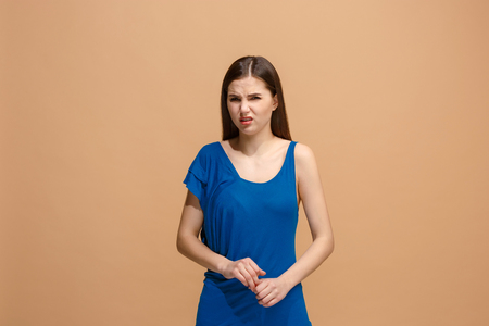 Disgust woman with thoughtful expression making choice against pastel background