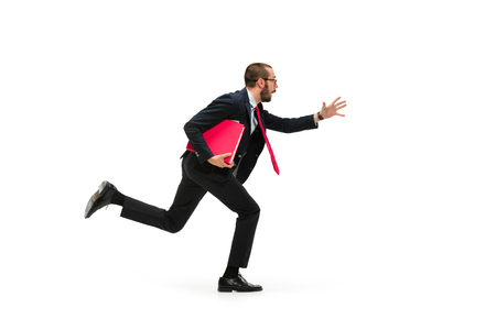 Businessman running with a folder on white background