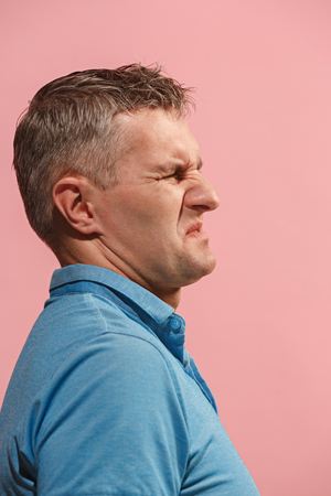 Let me think. Doubtful pensive man with thoughtful expression making choice against pink background