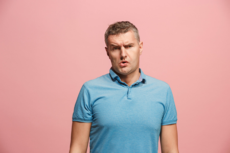 Beautiful bored man bored isolated on pink background Stock Photo