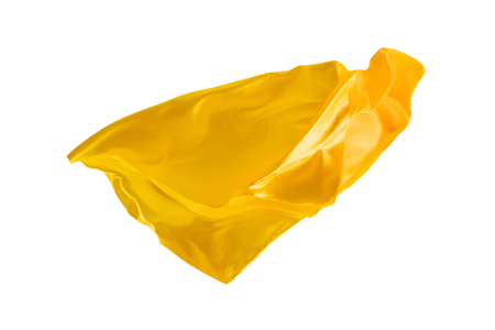 Smooth elegant transparent yellow cloth separated on white background.