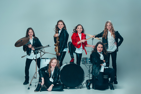 The teen music band performing in a recording studio