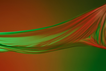 Smooth elegant transparent green cloth on green colored background.