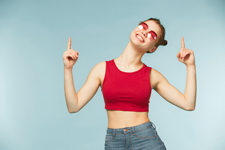 Woman smiling with perfect smile on the blue studio background Stock Photo