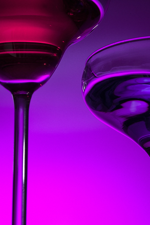 Two wine glasses standing on the table at studio