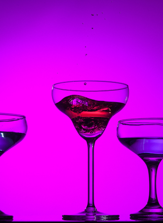 Three wine glasses standing on the table at studio