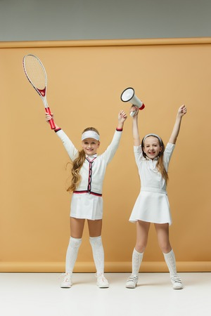Portrait of two girls as tennis players holding tennis racket. Studio shot. Zdjęcie Seryjne