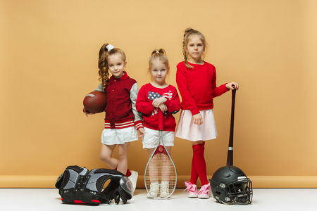 Happy and beautyful children show different sport. Studio fashion concept. Emotions concept.