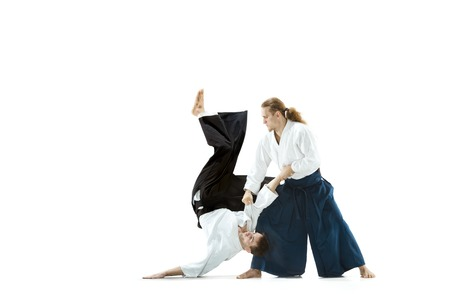 The two men fighting at Aikido training in martial arts school
