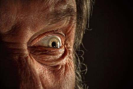 Close-up view on the eye of senior man. Stockfoto