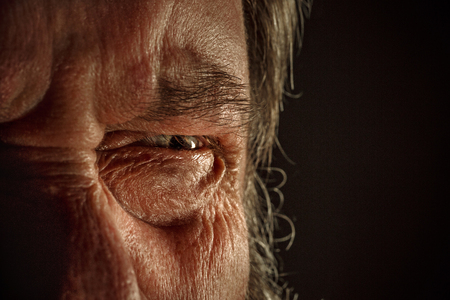 Close-up view on the eye of senior man. 版權商用圖片