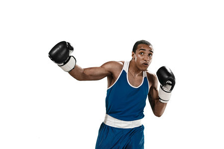 Sporty man during boxing exercise making hit. Photo of boxer on white background Stock Photo