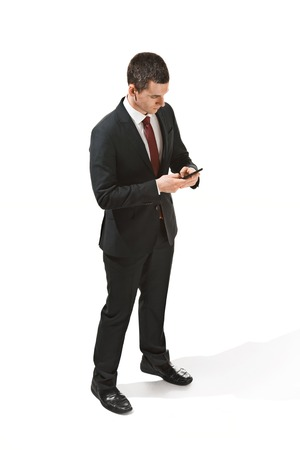 Three-quarter portrait of a businessman with very serious face. Confident professional with piercing look in the foreground of the camera. Stock Photo