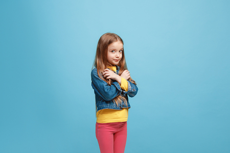 Beautiful teen girl looking suprised and bewildered isolated on blue Stock Photo