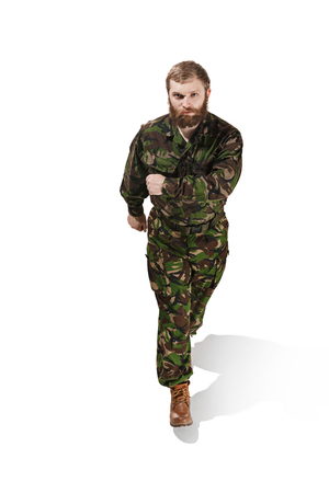 Young army soldier wearing camouflage uniform isolated on white 写真素材