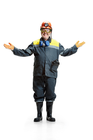 The studio shot of happy senior bearded male miner standing at the camera on a white background. 版權商用圖片