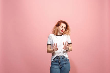 Let me think. Doubtful pensive woman with thoughtful expression making choice against pink background Фото со стока