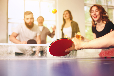 Group of happy young friends playing ping pong table tennis Archivio Fotografico - 101379606